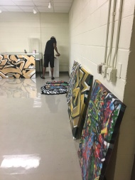 Graffiti artist, Troy Duff installing his canvas art