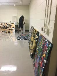 Graffiti artist, Troy Duff installing his canvas art